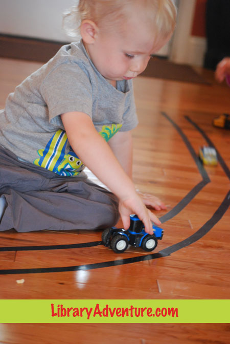 Electrical tape roadways, an activity to go with Big Wheels by Anne Rockwell on LibraryAdventure.com