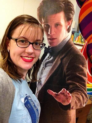 Photo of Shelley Harris and a cutout of the 11th doctor